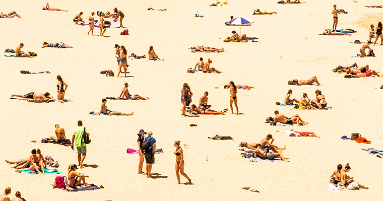 People on the beach, soaking up some vitamin D from the sun